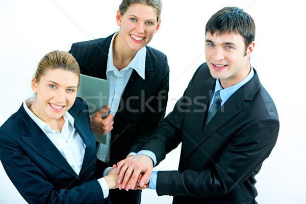 Affaires soutien image gens d'affaires mains haut Photo stock © pressmaster