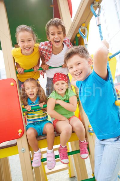 Szórakozás kép örömteli barátok játszótér kint Stock fotó © pressmaster