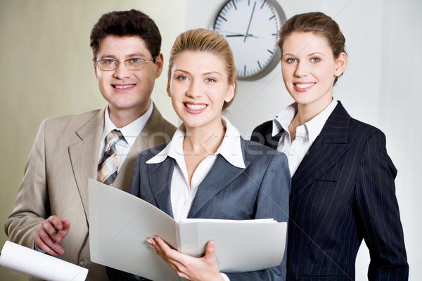 Tre persone ritratto tre sorridere guardando Foto d'archivio © pressmaster