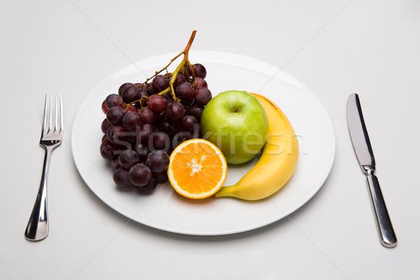 Dessert mélange de fruits blanche plaque fourche Photo stock © pressmaster