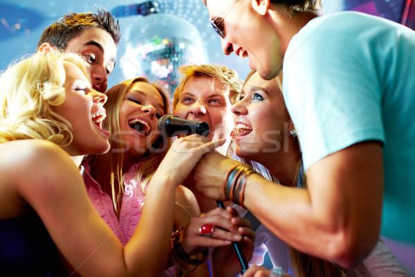 Singing friends Stock photo © pressmaster
