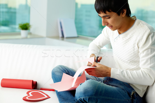 Cutting paper heart Stock photo © pressmaster