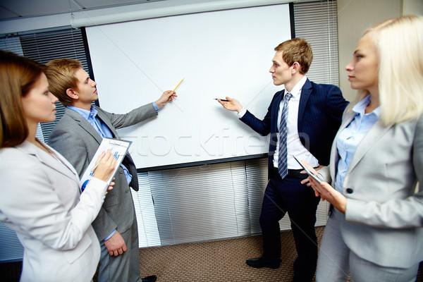 Dwa biznesmenów wskazując mowy Zdjęcia stock © pressmaster