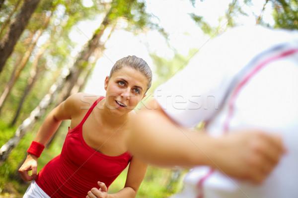 Fut futás kép boldog fiatal női Stock fotó © pressmaster