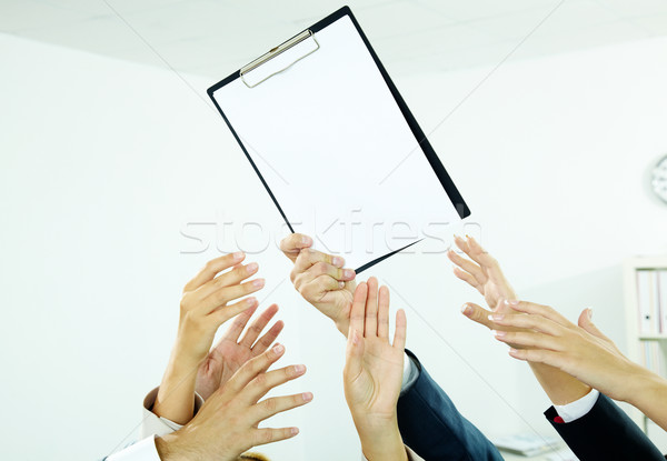 Reaching out for paper Stock photo © pressmaster