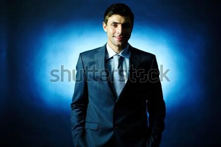 бизнесмен портрет элегантный глядя камеры темноте Сток-фото © pressmaster
