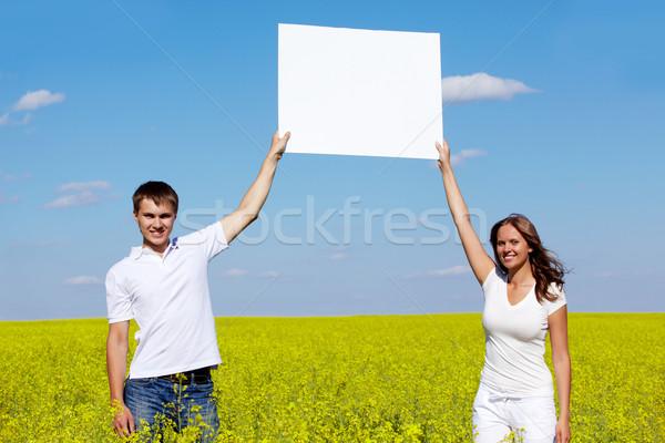 портрет счастливым парень девушки чистый лист бумаги Постоянный Сток-фото © pressmaster