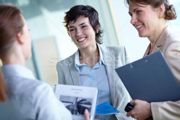 Interacción imagen feliz empresarias negocios mujer Foto stock © pressmaster