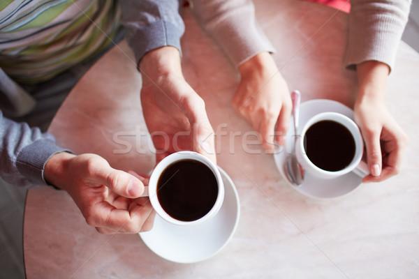 Stok fotoğraf: Kahve · görüntü · iki · eller · tarihleri