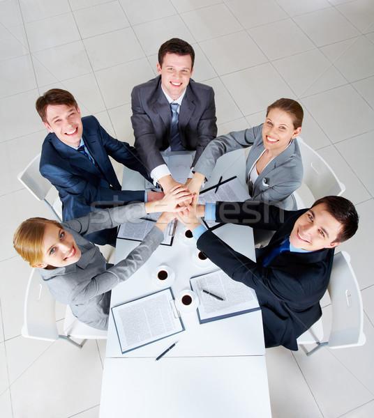 Acima ver pessoas de negócios mãos topo outro Foto stock © pressmaster