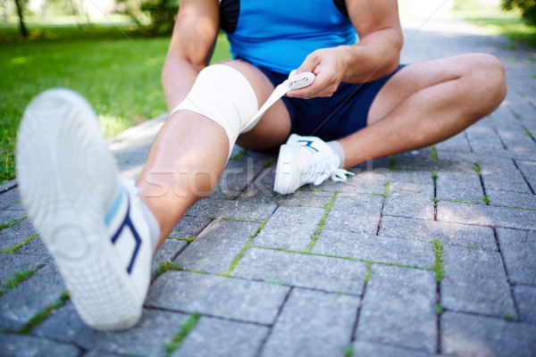 Bandaging leg Stock photo © pressmaster