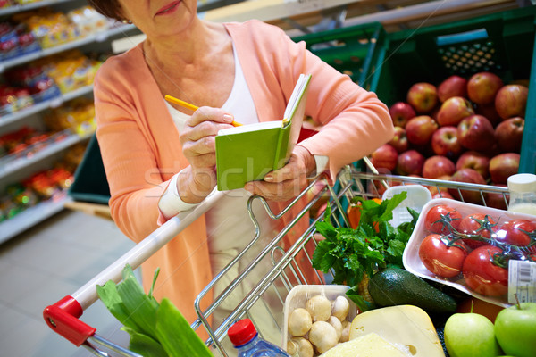 Stock photo: Shopper with notepad