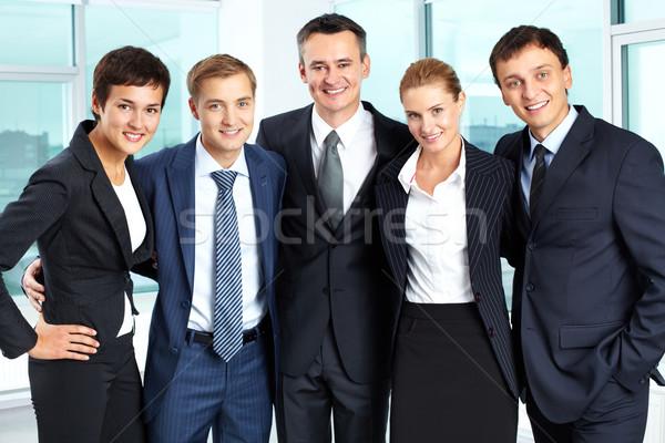 Boldog üzleti csoport portré sikeres átkarol egyéb Stock fotó © pressmaster