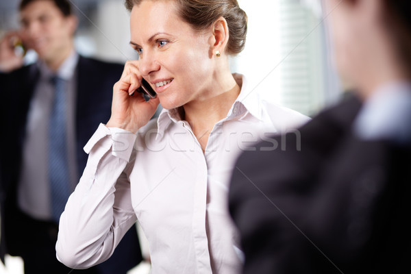 Businesswoman phoning Stock photo © pressmaster