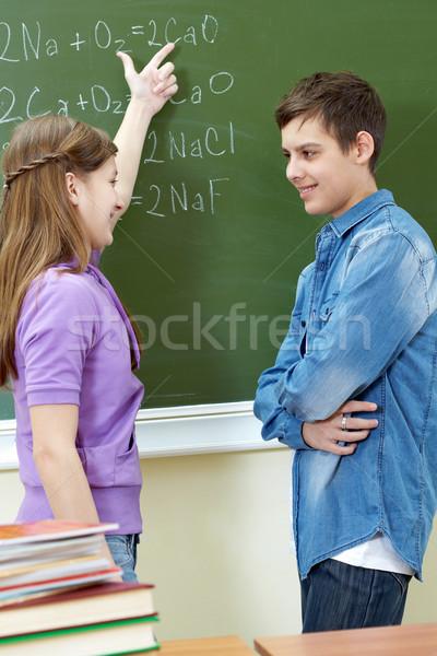 Toelichting formule knap meisje wijzend Blackboard Stockfoto © pressmaster