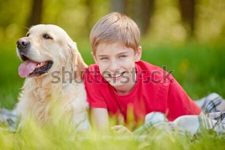 Lad and Labrador Stock photo © pressmaster