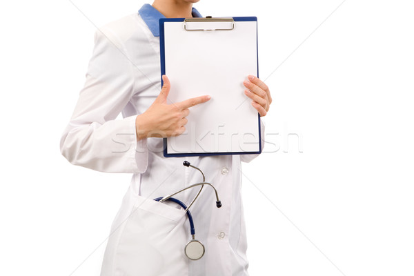 Foto stock: Mirar · primer · plano · enfermera · senalando · papel · en · blanco · manos