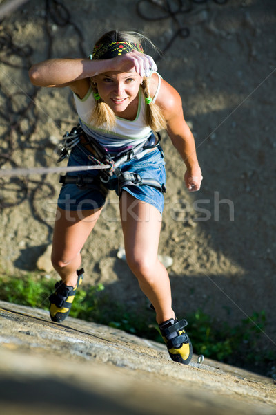 Image of woman hanging on the rope and looking at camera Stock photo © pressmaster