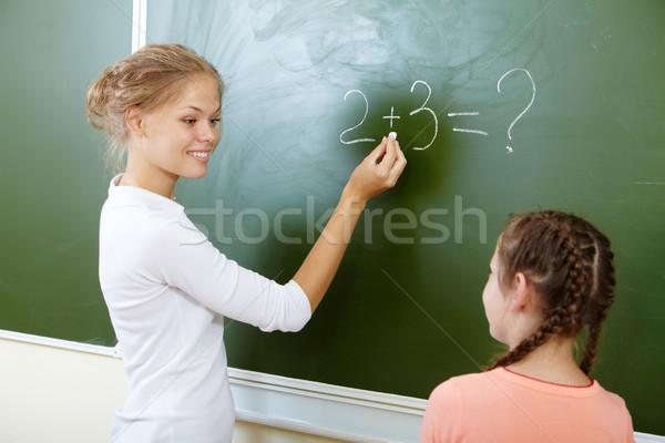 Iskolatábla fotó tanár ír összeg néz Stock fotó © pressmaster