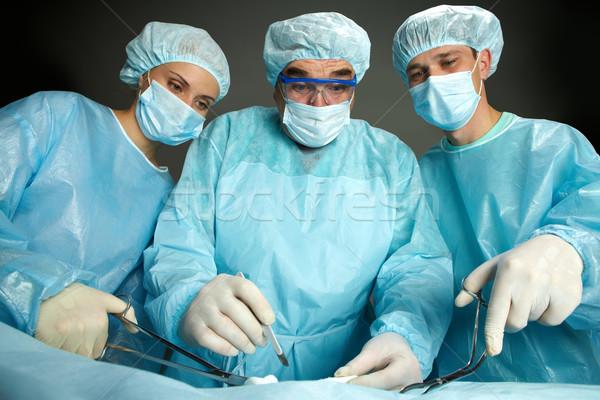 Photo stock: étonné · chirurgiens · portrait · trois · permanent · femme