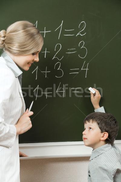 Consultor retrato diligente olhando professor lousa Foto stock © pressmaster