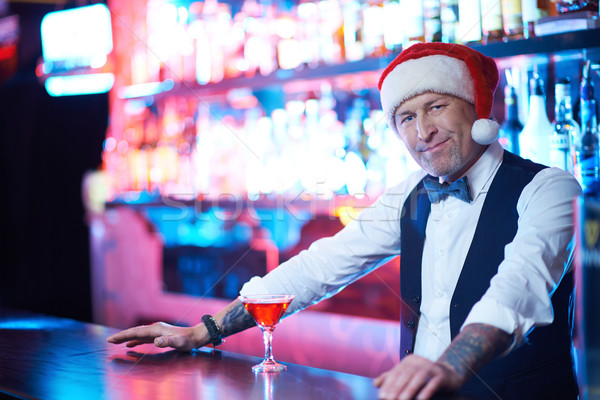 Barman in Santa cap Stock photo © pressmaster