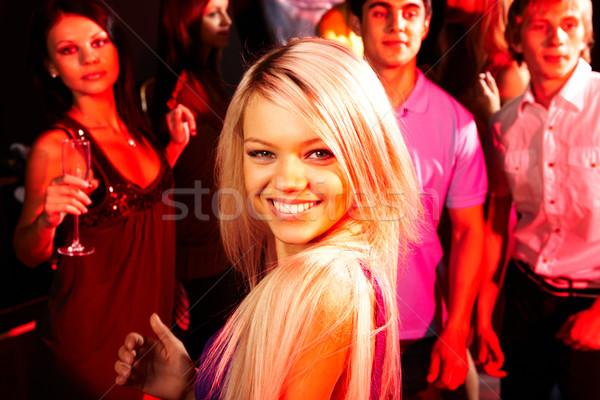 Csinos lány kép energikus néz kamera Stock fotó © pressmaster