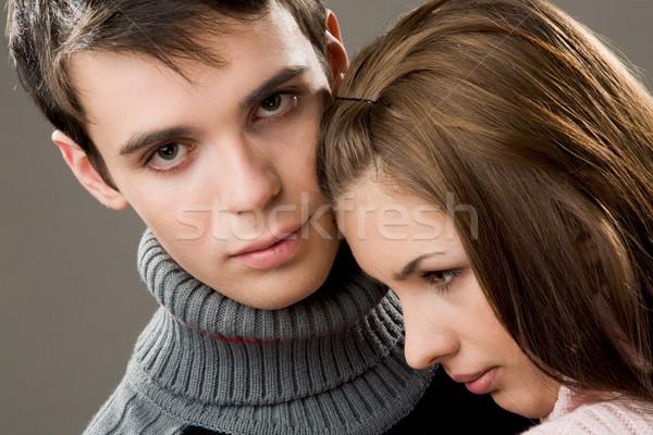 Szerelmi pár jóképű fickó néz kamera Stock fotó © pressmaster