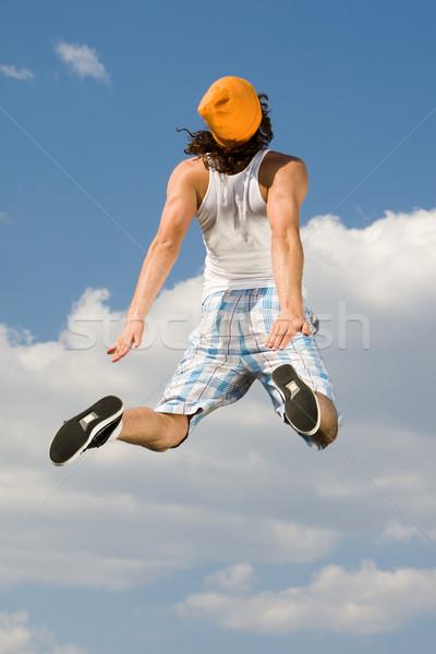 Dinamizmus hátsó nézet energikus fickó ugrik magas Stock fotó © pressmaster
