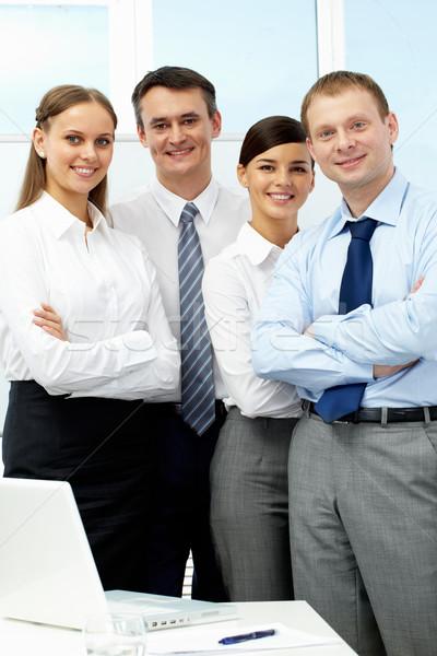 Barátságos üzleti csoport portré négy üzletemberek néz Stock fotó © pressmaster