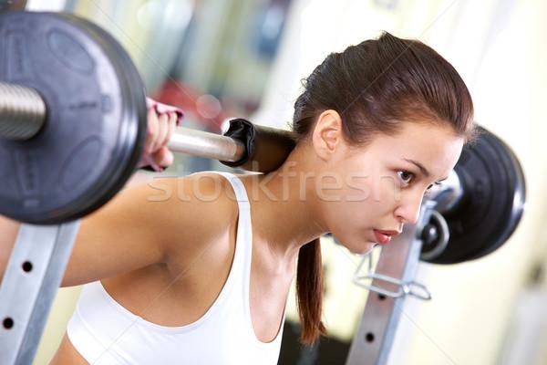 Gewichtheffen foto geschikt brunette oefenen vrouw Stockfoto © pressmaster