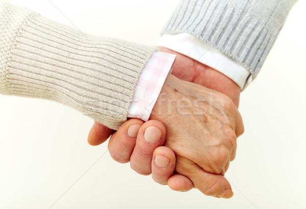 Bizalom támogatás idősek kéz a kézben elkötelezettség család Stock fotó © pressmaster