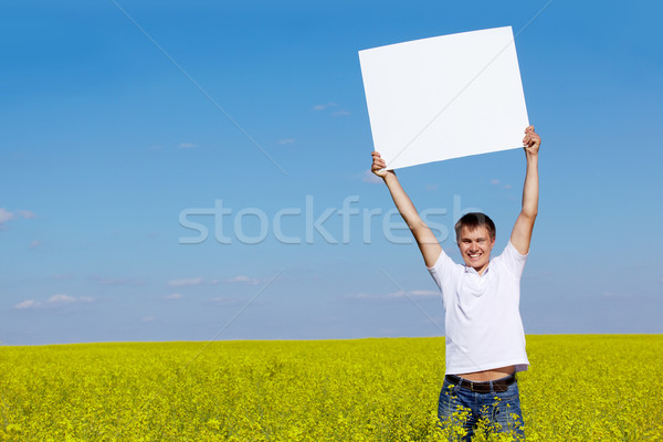 Stock photo: Guy with paper