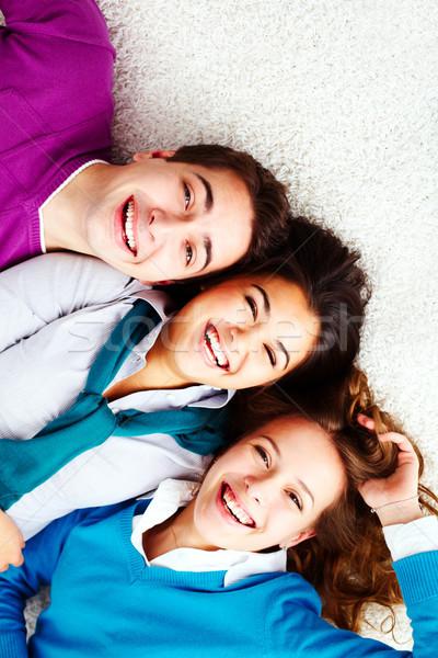 Foto d'archivio: Positività · sopra · angolo · di · tre · ridere · amici
