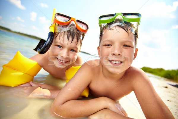 Siblings on beach Stock photo © pressmaster