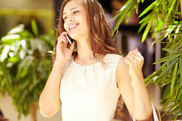 Phoning from mall Stock photo © pressmaster