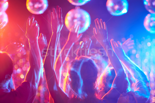 Mozog tánc tömeg fiatalok tánc éjszakai klub Stock fotó © pressmaster