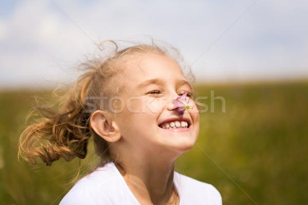 Smelling flower Stock photo © pressmaster