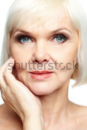łaskawy uśmiech dojrzały pani patrząc ciało Zdjęcia stock © pressmaster