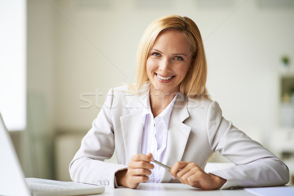 Businesswoman at workplace Stock photo © pressmaster