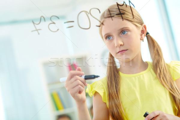 Astucieux écolière portrait fille transparent bord Photo stock © pressmaster