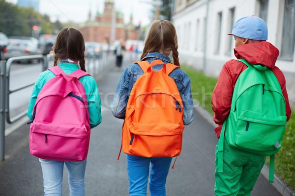 Iskola iskolás gyerekek színes mozog utca narancs Stock fotó © pressmaster