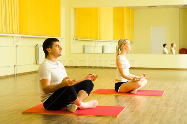 Meditáció fotó fiatalember nő ül együtt Stock fotó © pressmaster