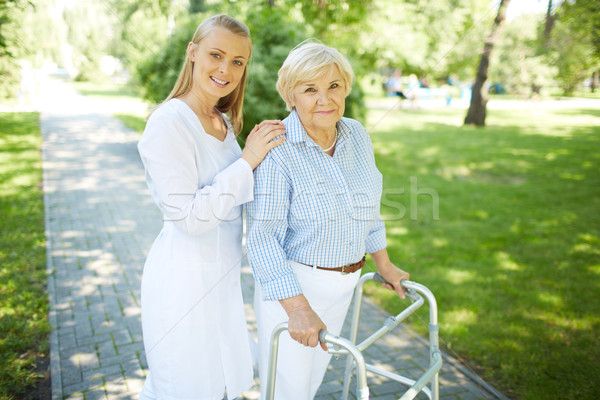 Gondozó idős női csinos nővér beteg Stock fotó © pressmaster