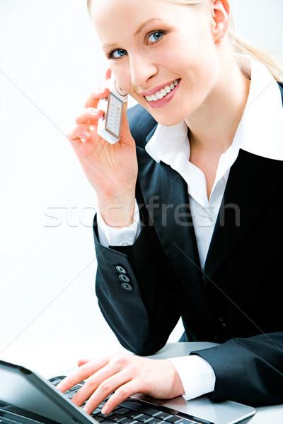 Especialista imagen bastante escribiendo portátil llamando Foto stock © pressmaster
