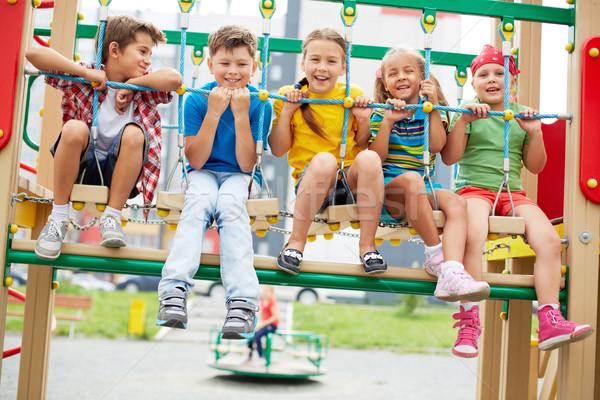 çocuklar salıncak mutlu arkadaşlar oturma bakıyor Stok fotoğraf © pressmaster