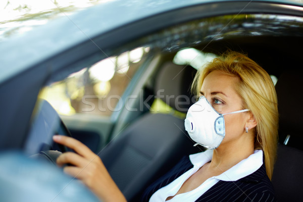 Driving in polluted zone Stock photo © pressmaster