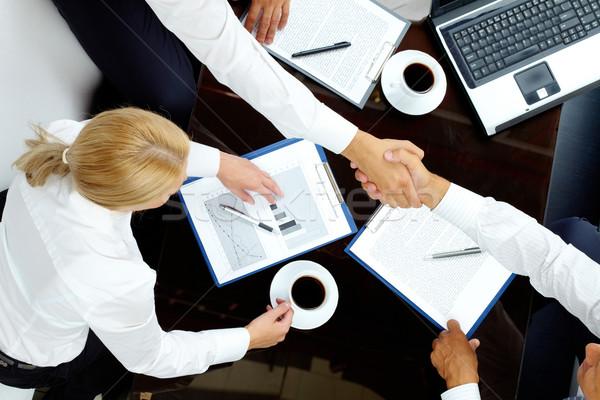交渉 画像 成功した パートナー ビジネス 紙 ストックフォト © pressmaster