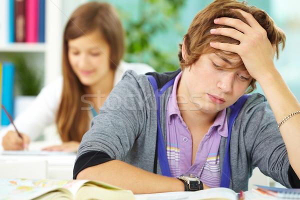 boy reading essay