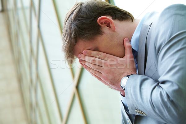 Yorgun işadamı kafa avuç içi dışında iş Stok fotoğraf © pressmaster
